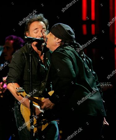 Bruce Springsteen, Stevie Van Zandt Bruce Springsteen sings with Steven Van Zandt as he and the E Street Band play a benefit concert for the renovation of the Count Basie Theatre in Red Bank, N.J