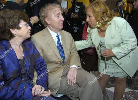 Gene Wilder, Margarita Cortavarria, Karen Wilder Fan Margarita Cortavarria, right, of Hartford, speaks with actor Gene Wilder, center, and his wife Karen prior Wilder receiving the Governor's Awards for Excellence in Culture and Tourism at the Legislative Office Building in Hartford, Conn., . Wilder was one of four recipients of the award given by the Connecticut Commission on Culture and Tourism