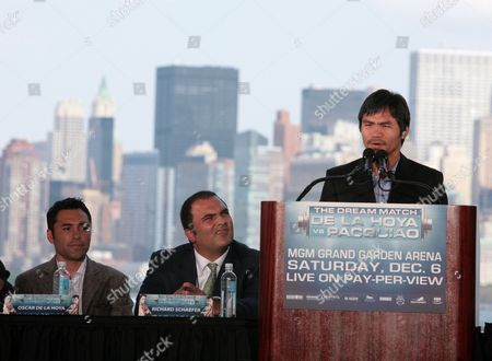 "Oscar De La Hoya, Richard Schaefer, Manny Pacquiao With the New York City skyline as a backdrop, Manny ""Pacman"" Pacquiao, right, speaks during a press conference as Oscar De La Hoya, left, and his promoter Bob Arum look on . De La Hoya and Pacquiao will square off in a 12-round welterweight bout on Saturday, Dec. 6, 2008, in Las Vegas"