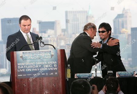 Richard Schaefer, Bob Arum, Manny Pacquiao Manny Pacquiao, right, hugs his promoter Bob Arum during a press conference, in New York. Pacquiao and Oscar De La Hoya will square off in a 12-round welterweight bout on Saturday, Dec. 6, 2008, in Las Vegas