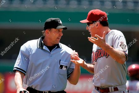 Bob Melvin; Jeff Kellogg Arizona Diamondbacks manager Bob Melvin, right, argues with umpire Jeff Kellogg after a second inning home run to right field by Diamondbacks' Mark Reynolds was ruled a book rule double in a baseball game at Pittsburgh . Melvin was ejected from the game by Fairchild