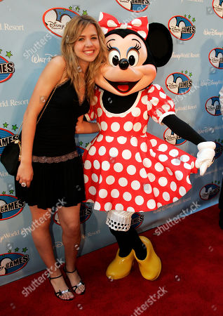 Andrea Guasch Andrea Guasch, of Spain, poses with Minnie Mouse at the Disney Channel Games in Lake Buena Vista, Fla