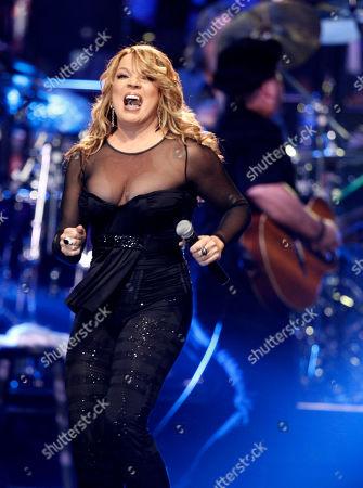 "Ednita Nazario Puerto Rico's Ednita Nazario performs at the Latin Recording Academy Person of the Year tribute to Gloria Estefan in Houston, Texas. Nazario, also a producer, will release her new album ""El corazón manda"" on Oct. 22, 2013"