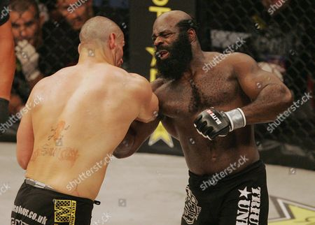 Kimbo Slice, James Thompson Kimbo Slice, right, throws a punch at James Thompson of Manchester, England during the first round of their EliteXC heavyweight bout at the Prudential Center in Newark, N.J. . Slice won in the third round on a TKO