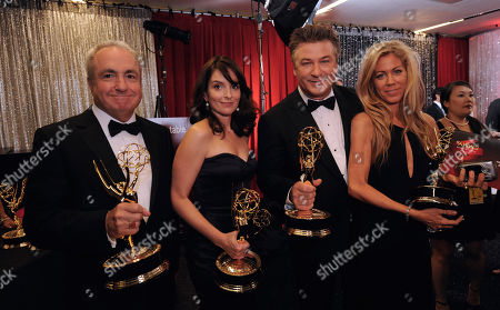 """Lorne Michaels, Marci Klein, Alec Baldwin, Tina Fey 30 Rock"""" executive producer Lorne Michaels, left, and Marci Klein, far right, pose backstage with actor Alec Baldwin and actress and executive producer Tina Fey at the 60th Primetime Emmy Awards in Los Angeles, . """"30 Rock"""" won the award for outstanding comedy series"""