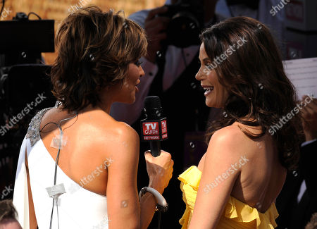 "Terri Hatcher, Lisa Rinna Desperate Housewives"" actress Terri Hatcher talks to Lisa Rinna, left, as she arrives at the 60th Primetime Emmy Awards in Los Angeles"