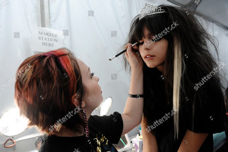 Stock Photo of Mary Palmer, Amanda Pizziconi Stylist Mary Palmer works on model Amanda Pizziconi before Christian Audigier Presents American Lord show during Mercedes-Benz fashion week in Culver City, Calif