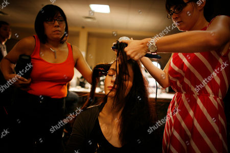 A model prepares backstage for the showing of the spring 2009 collection of Issac Mizrahi during Fashion Week in New York
