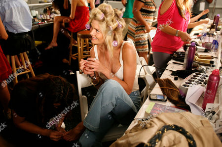 May Andersen Model May andersen of Denmark has her toenails done as she prepares backstage for the Diesel swimwear show during the 2008 Mercedes-Benz Fashion Week Swim event in Miami Beach, Fla