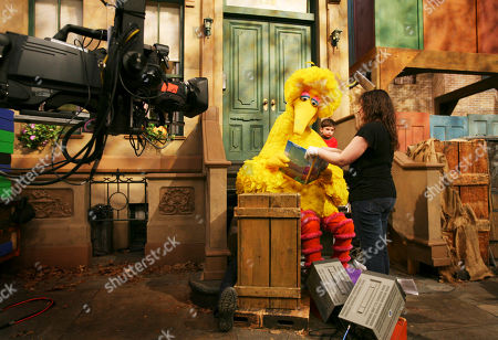 "Caroll Spinney, Big Bird Michelle Hickey, a Muppet wrangler adjusts a book for Big Bird, voiced by Carroll Spinney, so he can read to Connor Scott during a taping of Sesame Street in New York. Spinney drops his fine-feathered obscurity (and emerges from his garbage-can fortress as Oscar the Grouch) for an enchanting film portrait, ""I Am Big Bird: The Caroll Spinney Story,"" which celebrates the ""Sesame Street"" puppet master who, at age 81, continues to breathe life into a pair of the world's best-loved personalities"