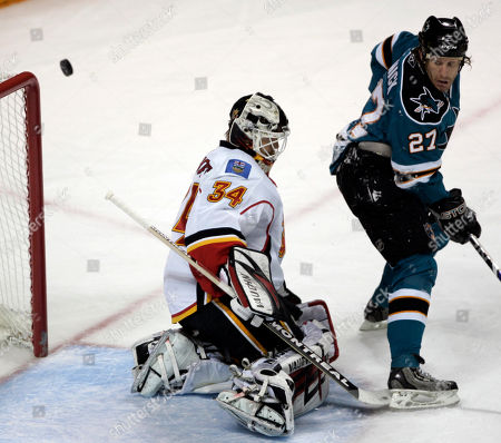 Miikka Kiprusoff, Jeremy Roenick San Jose Sharks center Jeremy Roenick (27) is unable to score past Calgary Flames goalie Miikka Kiprusoff (34), of Finland, in the first period in Game 7 of an NHL hockey Western Conference playoff series, in San Jose, Calif