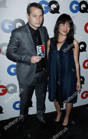 "Shepard Fairey, Amanda Fairey Shepard Fairey, left, and his wife, Amanda, arrive at the GQ magazine 2008 ""Men of the Year"" party in Los Angeles on"