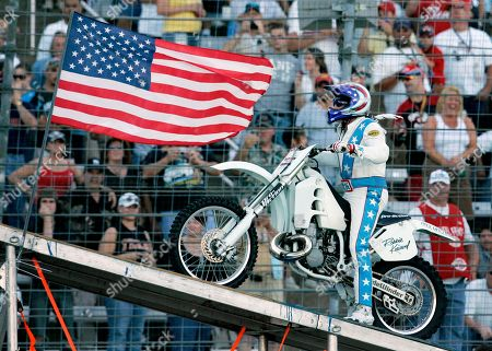 Robbie Knievel Stunt motorcycle driver Robbie Knievel slowly makes his way up a ramp prior to making his jump over 21 Hummers at Texas Motor Speedway, in Fort Worth
