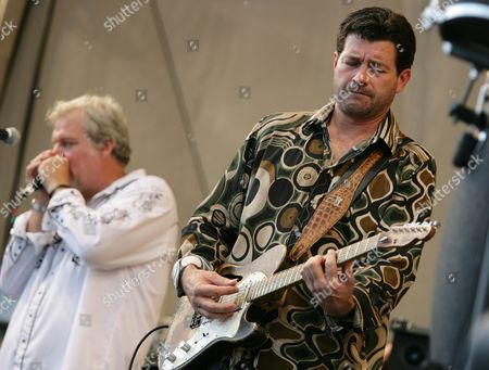 Johnny Sansone, Tab Benoit Johnny Sansone, left, and Tab Benoit perform with the Voice of the Wetlands Allstars during the 2008 New Orleans Jazz & Heritage Festival in New Orleans