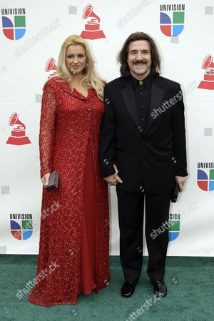 Luis Cobos, Patricia Cobos Chairman of the Latin Recording Academy Luis Cobos (R) and his wife Patricia arrive at the 9th annual Latin Grammy Awards on in Houston