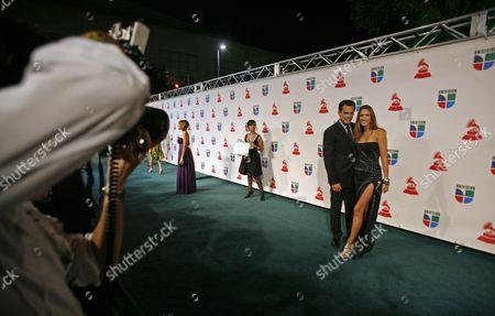 Cristian de la Fuente, Angelica Castro Photographers work the arrivals line as Cristian de la Fuente and his wife Angelica Castro arrive at the 9th annual Latin Grammy Awards on in Houston
