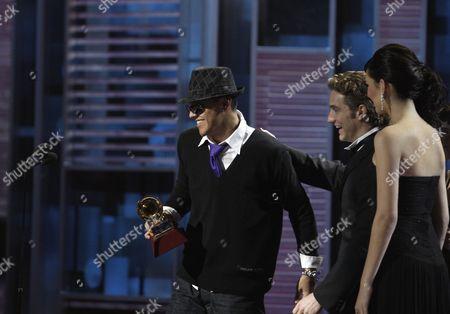 Flex, Eugenio Siller Flex, left, accepts the award for best urban song from Eugenio Siller at the 9th annual Latin Grammy Awards on in Houston