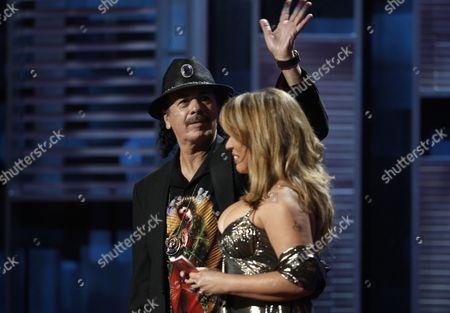 Carlos Santana, Ednita Nazario Carlos Santana and Ednita Nazario present the record of the year award at the 9th annual Latin Grammy Awards on in Houston