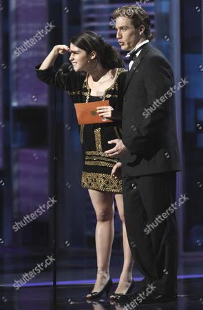 Ximena Sarinana, Eugenio Siller Ximena Sarinana, left, and Eugenio Siller present the award for best urban song at the 9th annual Latin Grammy Awards on in Houston