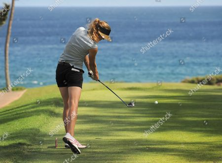 Anna Rawson Anna Rawson, of Australia, hits from the fourth tee of Kapalua Resort during the first round of the inaugural Kapalua LPGA Classic golf tournament in Kapalua, Hawaii