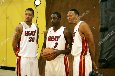 Michael Beasley, Dwyane Wade, Shawn Marion Miami Heat basketball players Michael Beasley, left, Dwyane Wade, center, and Shawn Marion pose during the annual media day, in Miami