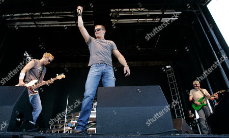 """Brad Arnold, Todd Harrell, Matt Roberts From left, Todd Harrell, Brad Arnold, and Matt Roberts, of 3 Doors Down performing during a concert before the NASCAR Sprint All-Star Race at Lowe's Motor Speedway in Concord, N.C. Harrell has been suspended indefinitely from the band following his DUI arrest. Todd Harrell was charged Tuesday in Mississippi with a second-offense DUI involving a substance other than alcohol. The rock group says in a statement Thursday that Harrell has been suspended to """"protect the image and integrity of the band"""