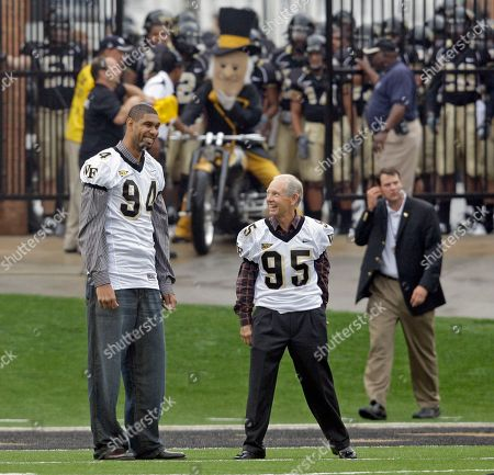 Tim Duncan, Dave Odom Former Wake Forest basketball star Tim Duncan, left, and former coach Dave Odom, right, are shown before a college football game in Winston-Salem, N.C