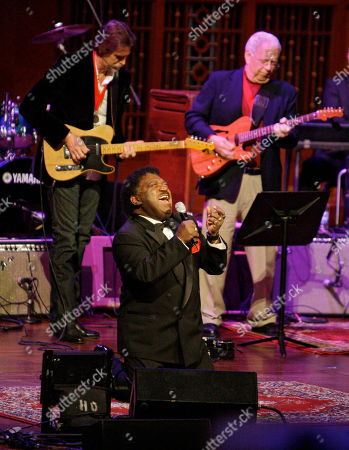 """Percy Sledge Percy Sledge kneels as he performs """"When a Man Loves a Woman"""" along with the Muscle Shoals Rhythm Section at the Musicians Hall of Fame awards show in Nashville, Tenn. Sledge, who recorded the classic 1966 soul ballad """"When a Man Loves a Woman,"""" died, . He was 74"""