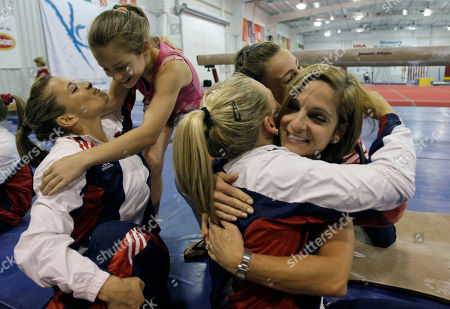 Mary Lou Retton, McKenna Kelley, Samantha Peszek, Alicia Sacramone Olympian Mary Lou Retton, right, hugs Samantha Peszek as Retton's daughter McKennea Kelley, second from left, hugs Alicia Sacramone after the final day of competition at the USA Gymnastics Olympic selection camp in New Waverly, Texas. Sacramone and Peszek were both selected for the Olympic team