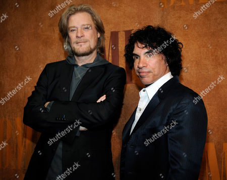 """Daryl Hall, John Oates Daryl Hall, left, and John Oates, recipients of BMI Icons awards, pose together before the 56th annual BMI Pop Awards in Beverly Hills, Calif. The pop music duo has sued Brooklyn, N.Y. based Early Bird Foods in federal court. The suit asks the court to order Early Bird Foods to stop using the Haulin' Oats name on packages of granola. They're accusing the company of violating trademark protections with its """"phonetic play on Daryl Hall and John Oates' well-known brand name"""