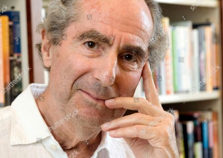 """Philip Roth Author Philip Roth poses for a photo in the offices of his publisher Houghton Mifflin, in New York. Roth apparently still isn't done with his retirement, especially when tempted by the chance to chat with Stephen Colbert. Comedy Central spokesman Steve Albani told The Associated Press, the celebrated novelist has agreed to an """"extended interview"""" in July for the cOlbert Book Club"""