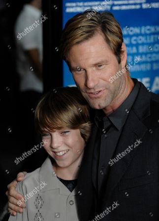 "Aaron Eckhart, Chase Ellison Cast members Aaron Eckhart, right, and Chase Ellison pose together at the premiere of the film ""Towelhead"" in Los Angeles"