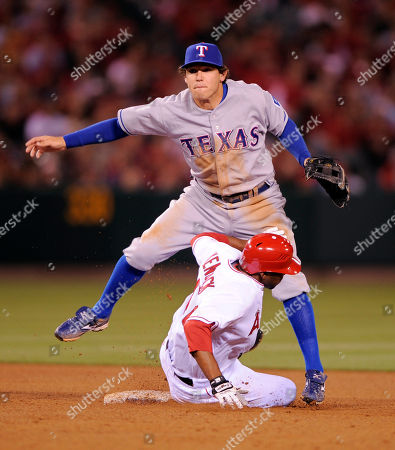 Howie Kendrick; Ian Kinsler Los Angeles Angels' Howie Kendrick is forced out at second as Texas Rangers second baseman Ian Kinsler throws out Robb Quinlan at first to complete the double play during the fourth inning of their Major League Baseball game, in Anaheim, Calif