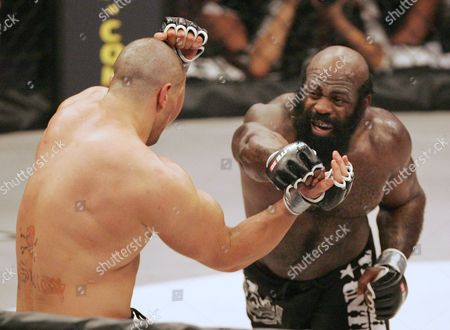 Kimbo Slice, James Thompson Fighter Kimbo Slice, right, throws a punch at James Thompson of Manchester, England during the second round of their EliteXC heavyweight mixed-martial arts bout at the Prudential Center in Newark, N.J. Slice could have faded into wealthy obscurity after earning a fortune and becoming the biggest name in mixed martial arts a few years ago. Instead, the former strip-club bouncer dedicated himself to learning the sport's finer points, and he hopes to show off his progress at UFC 113 this weekend