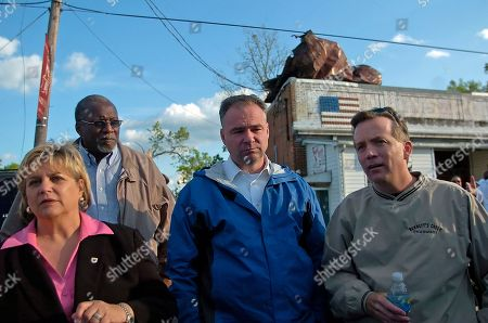 Virginia Governor, Tim Kaine, center, along with the mayor of Suffolk, Va., Linda Johnson, left, and the former mayor of Suffolk, Va., Chris Jones, right, listen to stories from local emergency personnel, about the tornado that ripped through the small Suffolk community of Driver