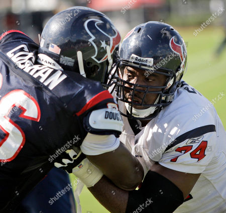 Earl Cochran, Ephraim Salaam Houston Texans tackle Ephraim Salaam (74), Houston Texans defensive end Earl Cochran (96) during a training camp workout in Houston