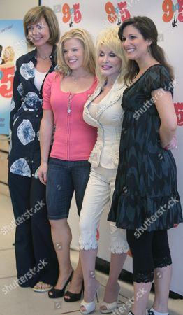 """Allison Janney, far left, Megan Hilty, second from left, Dolly Parton, second from right, and Stephanie Block, far right, pose during a press conference for the new musical """"9 To 5"""" in New York, Tuesday July 15, 2008"""