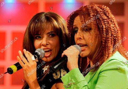 Gloria Trevi, Albita Gloria Trevi, of Mexico, left, and Albita perform during the recording of 'La Descarga Con Albita' hispanic television show in Miami
