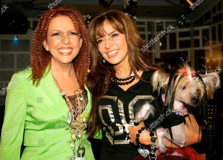 Gloria Trevi, Albita, left, and Gloria Trevi, of Mexico, pose with Albita's mascot 'La China' after the recording of the La Descarga Con Albita' hispanic television show in Miami
