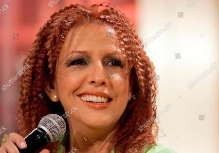 "Albita performs during the recording of 'La Descarga Con Albita' television show in Miami. Cuba's singer Albita presented on her latest album ""Una mujer que canta"" which includes one song with the late salsa queen Celia Cruz, recorded in 2002"