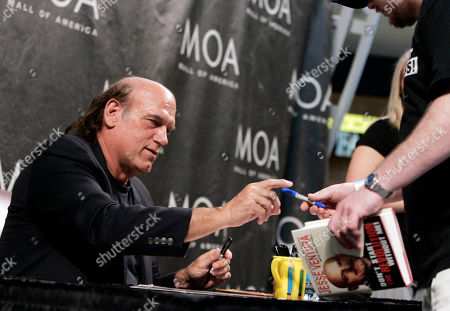 """Jesse Ventura Former Minnesota Gov. Jesse Ventura signs his new book, """"Don't Start the Revolution Without Me,"""" during an appearance at the Mall of America in Bloomington, Minn. Ventura contends he isn't going after the widow of slain """"American Sniper"""" author Chris Kyle by continuing his defamation lawsuit. Ventura told The Associated Press late, his fight is with the publisher's insurance company"""