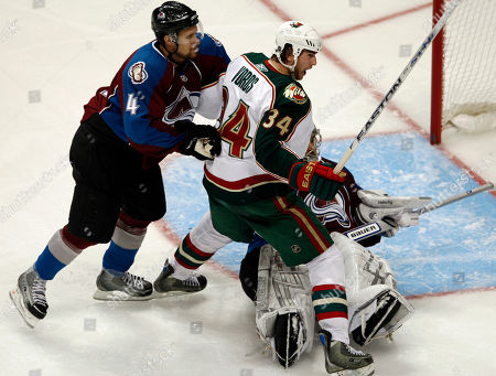 Aaron Voros, John-Michael Liles, Jose Theodore Minnesota Wild left winger Aaron Voros, center, reacts after getting called for goalie interference as Colorado Avalanche goalie Jose Theodore, right, and defenseman John-Michael Liles look on in the second period of Game 3 of the teams' NHL first-round playoff series in Denver on