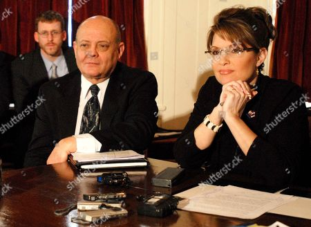 Tom Irwin; Sarah Palin Commissioner of the Department of Natural Resources Tom Irwin, left, answers a question from a member of the press during a press conference at the Governor's Mansion, in Juneau, AK . Governor Sarah Palin is to his right