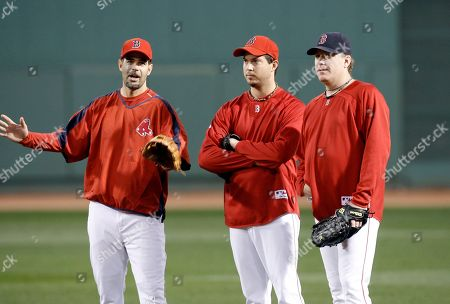 Josh Beckett, Curt Schilling, Mike Lowell Boston Red Sox Mike Lowell, left, Josh Beckett, center, and Curt Schilling talk in the outfield during batting practice before Game 7 of the American League Championship baseball series between the Red Sox and Cleveland Indians, at Fenway Park in Boston