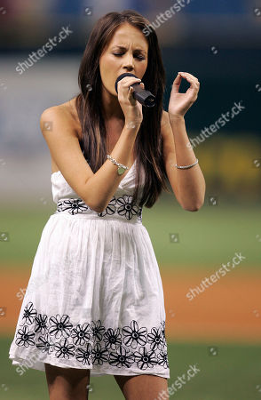 Samantha Jade Jive Records recording artist Samantha Jade sings the national anthem before the start of the Los Angeles Angels and Tampa Bay Devil Rays baseball game, in St. Petersburg, Fla