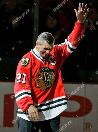 Bobby Hull, Stan Mikita Chicago Blackhawks great Stan Mikita waves to fans as they as he is introduced before an NHL hockey game against the San Jose Sharks in Chicago. The family of Stan Mikita says the Blackhawks Hall of Famer no longer has memories of his exceptional career on the ice because of a progressive brain disorder