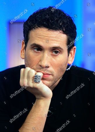 """Marc Ecko Fashion designer Marc Ecko holds the baseball hit by San Francisco Giants Barry Bonds for his record-breaking 756th home during Ecko's appearance on the NBC """"Today"""" television program in New York, . Ecko, who bought the ball in an online auction for $752,000, set up a Web site for fans to vote on the ball's fate, and the decision to brand it with an asterisk and send it to the Baseball Hall of Fame was revealed by him on the show"""