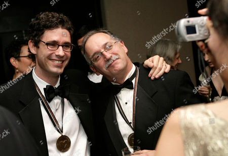 Joshua Ferris, Jim Shepard Authors Joshua Ferris, left, and Jim Shepard get their picture taken during a reception for the 58th National Book Awards in New York. The Americans have arrived in force for Britain's Booker literary prize. Five U.S.-based writers are on the 13-book long-list for the prestigious fiction award. The list, announced Wednesday, July 23, 2014, includes Americans Joshua Ferris, Karen Joy Fowler, Siri Hustvedt and Richard Powers, as well as Irish-American writer Joseph O'Neill