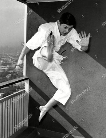 """A karate enthusiast for several years, Burt Ward practices his skill on the balcony of his apartment in west in West Los Angeles. His karate ability helped Burt win part of robin, the boy wonder, in the """"Batman"""" series. It marks his first appearance as an actor anywhere. Although slight of build, at 5'8"""" and 125 pounds, Burt has been an outstanding athlete since grammar school days"""