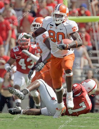 Aaron Kelly, DaJuan Morgan Clemson's Aaron Kelly (80) runs over North Carolina State's DaJuan Morgan (7) during the second half of a college football game in Raleigh, N.C., . Clemson won 42-20